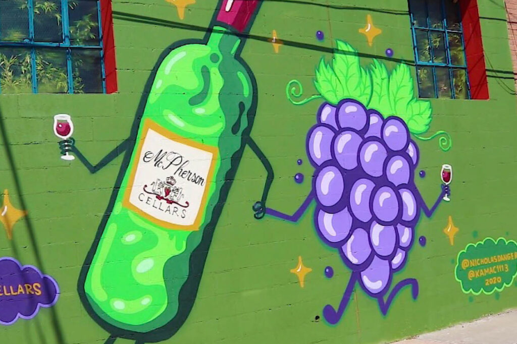 cartoon of wine bottle and grapes with glasses of wine playing hand in hand.
