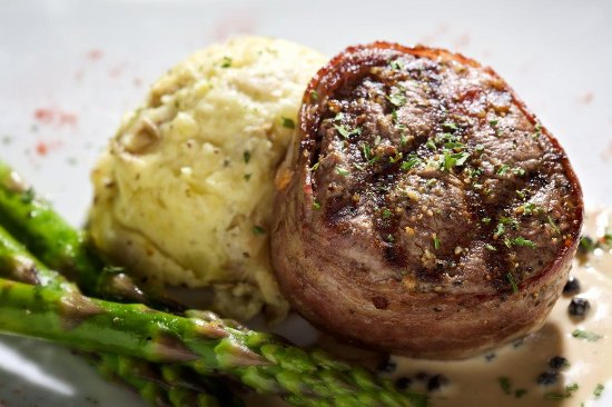 a plate of a steak filet, mashed potatoes, and asparagus.