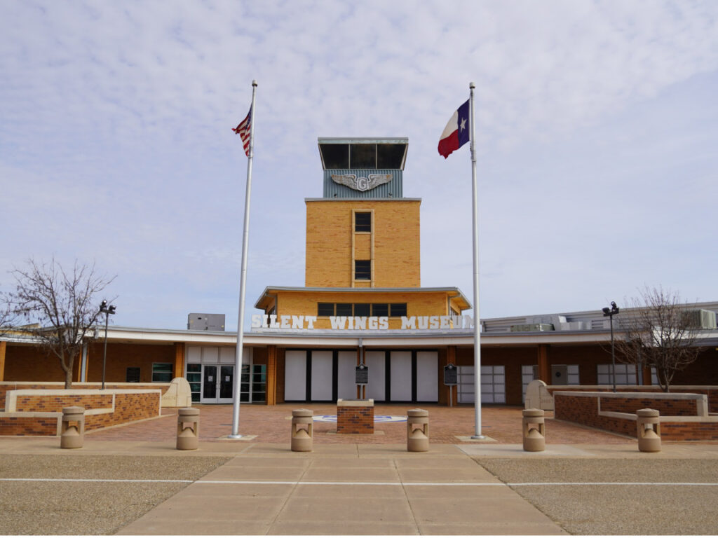 Front of the Silent Wing Museum. American flags in front.