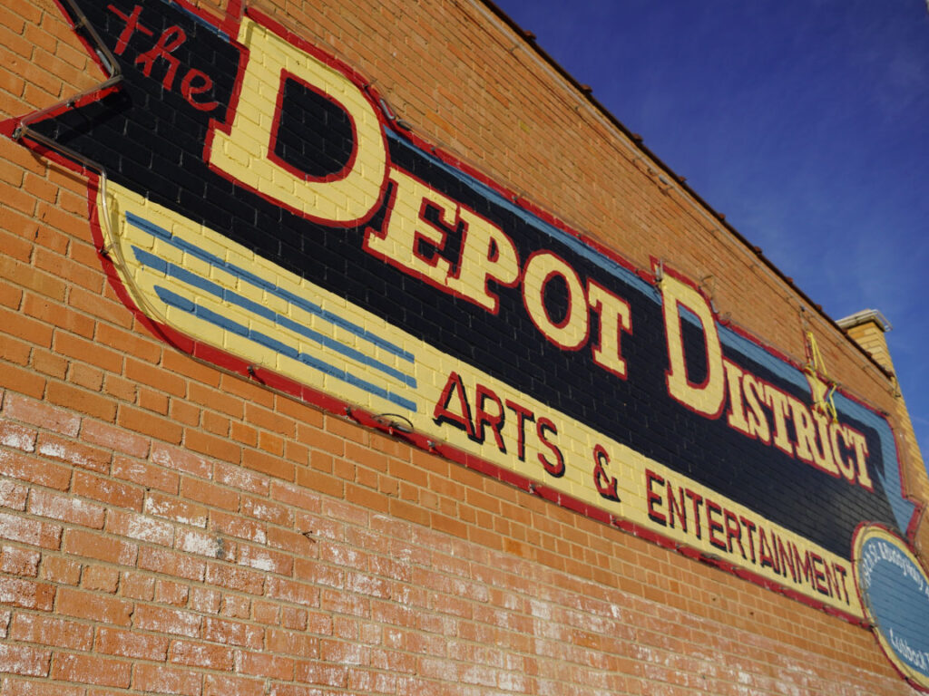 Brick wall of the words Depot District