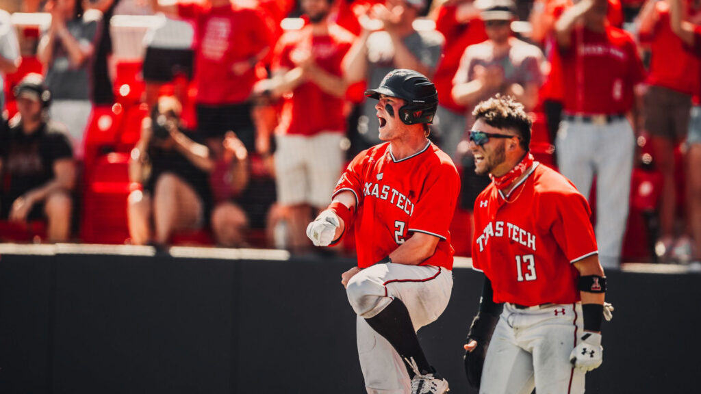 Baseball Players from Texas Tech celebrate a big play during a home game in Lubbock, TX.
