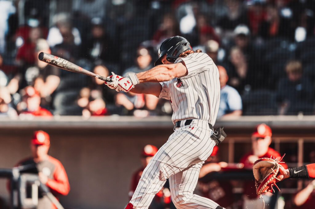 Texas Tech player swinging at the ball