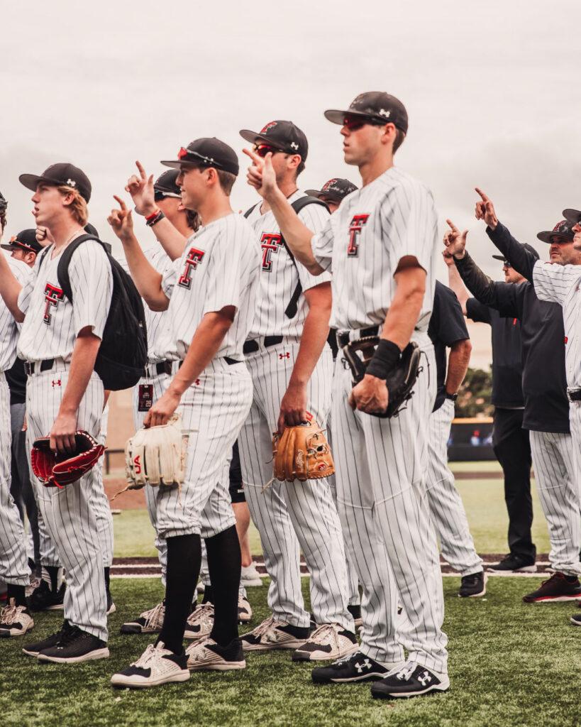 Texas Tech Baseball teams throws up their guns after a successful game two against Kansas.