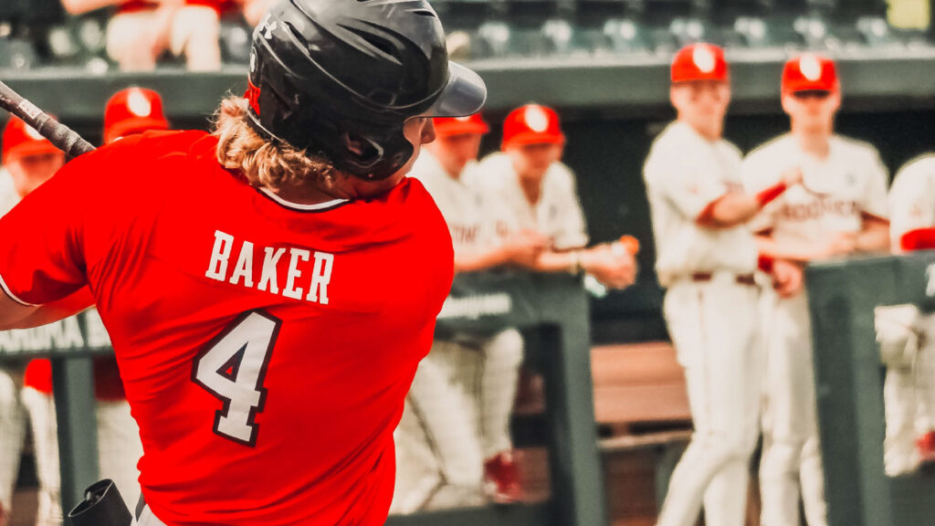 Red Raider Dru Baker hits a ball against OU in game two.