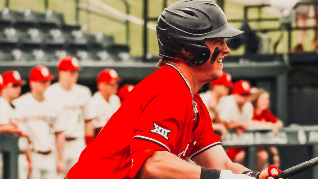 Red Raider Jace Jung looks eagerly as he hits a ball against OU.