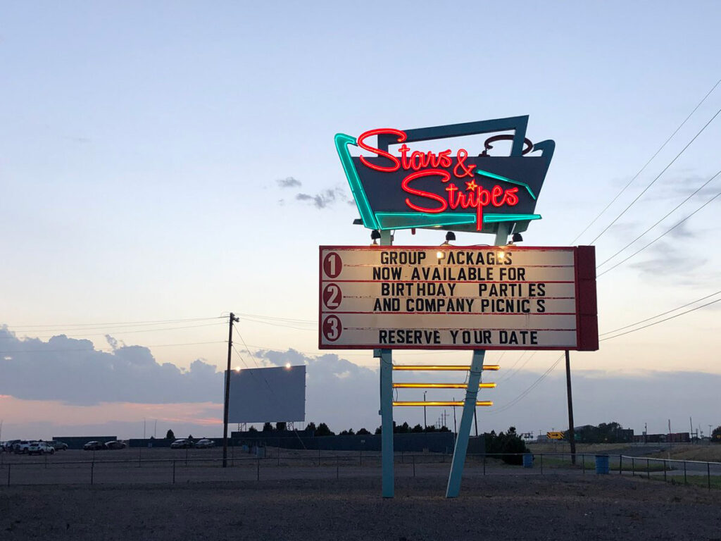 the stars and strips drive in neon sign
